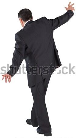 Maturité affaires équilibrage acte blanche costume Photo stock © wavebreak_media