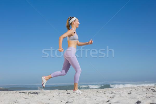 スポーティー ブロンド ビーチ ジョギング 海 ストックフォト © wavebreak_media