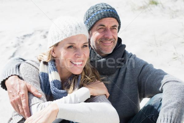 привлекательный пару улыбаясь пляж теплая одежда ярко Сток-фото © wavebreak_media