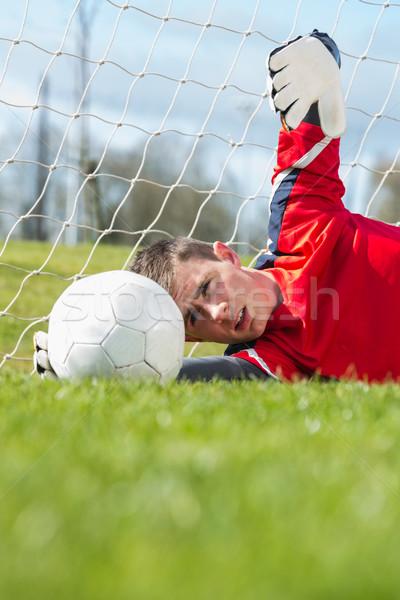 Kapus piros készít mentés fű sport Stock fotó © wavebreak_media