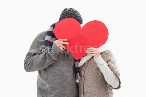 Happy mature couple in winter clothes holding red heart Stock photo © wavebreak_media