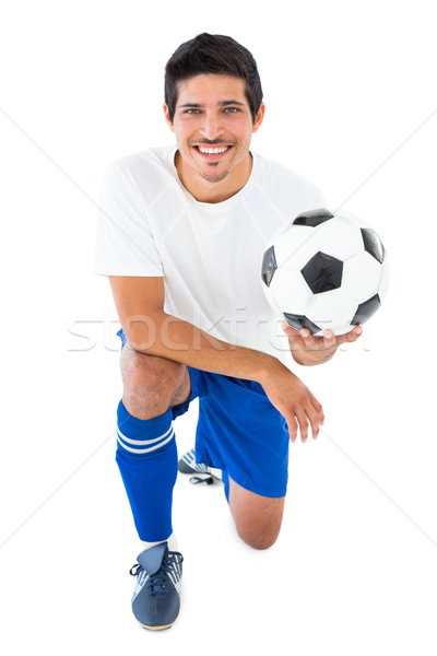 Football player in blue kneeling with ball Stock photo © wavebreak_media