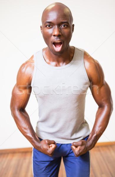 Muscular man shouting while flexing muscles Stock photo © wavebreak_media