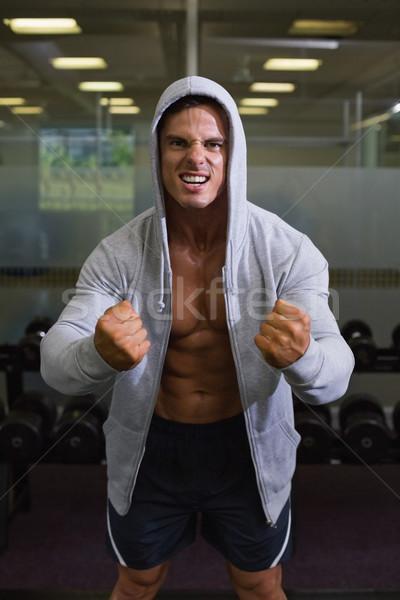 Muscular man clenching fists in health club Stock photo © wavebreak_media