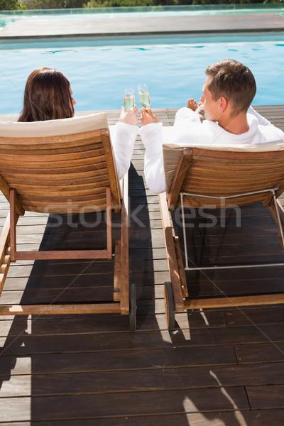 Couple toasting champagne by swimming pool Stock photo © wavebreak_media
