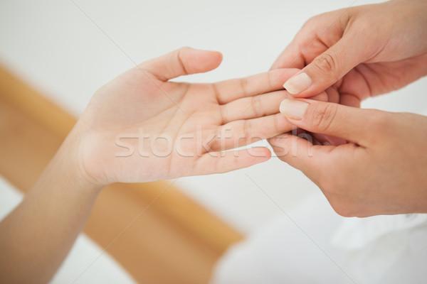 Woman receiving a hand massage  Stock photo © wavebreak_media