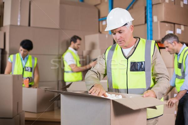 Raktár munkások citromsárga szállítmány nagy üzlet Stock fotó © wavebreak_media