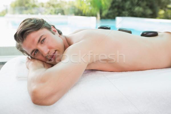 Bell'uomo pietra massaggio spa centro vista laterale Foto d'archivio © wavebreak_media
