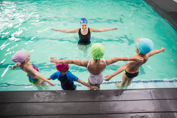 Cute swimming class watching the coach Stock photo © wavebreak_media