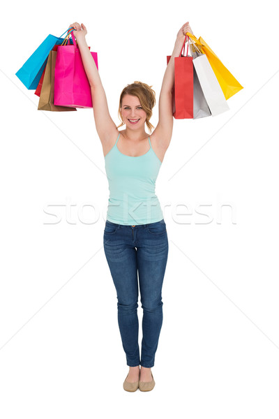 Excited blonde holding up shopping bags Stock photo © wavebreak_media