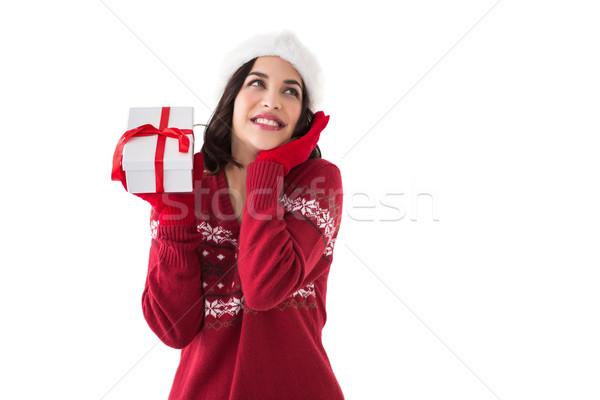 Zdziwiony brunetka Święty mikołaj hat dar Zdjęcia stock © wavebreak_media