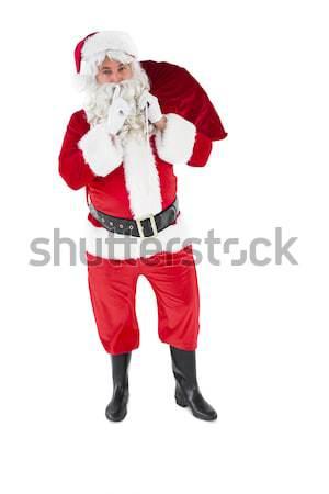 Mikulás tart zsák titok fehér boldog Stock fotó © wavebreak_media