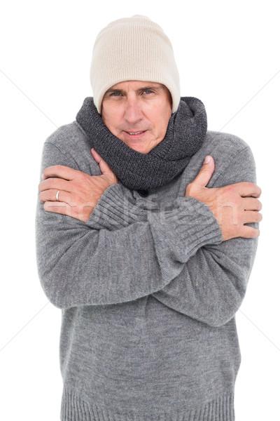 Casual man shivering in warm clothing Stock photo © wavebreak_media