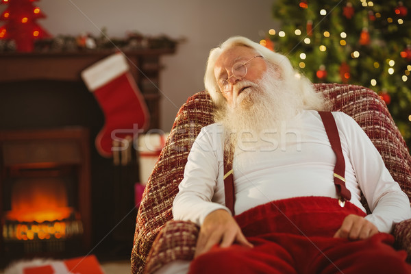 Santa claus napping on the armchair Stock photo © wavebreak_media