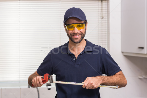 Plumber fixing pipe with wrench Stock photo © wavebreak_media