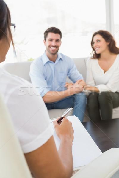 Smiling couple speaking with their therapist  Stock photo © wavebreak_media