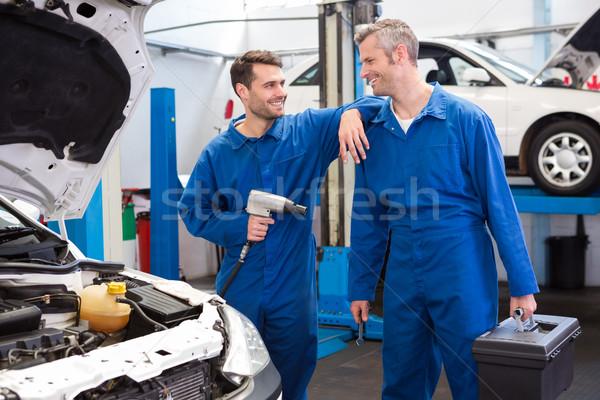 Squadra meccanica riparazione garage felice Foto d'archivio © wavebreak_media