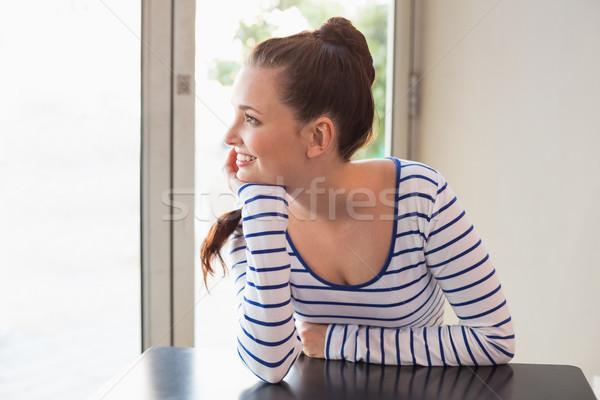 Pretty brunette smiling at the table Stock photo © wavebreak_media