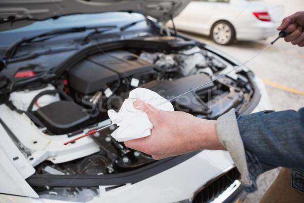 Close up of man checking car engine oil Stock photo © wavebreak_media