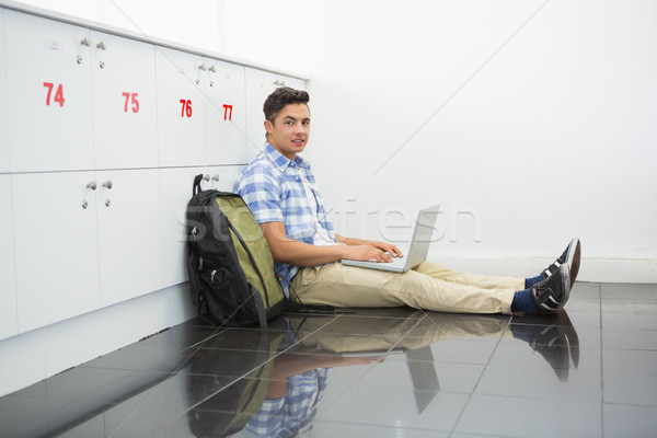 Smiling college student sitting on the floor with laptop Stock photo © wavebreak_media
