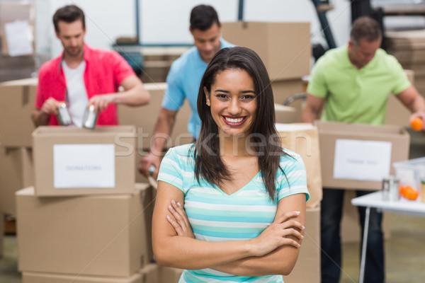 Portret glimlachend vrijwilliger groot magazijn Stockfoto © wavebreak_media