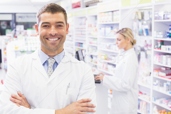 Smiling pharmacist standing with arms crossed Stock photo © wavebreak_media