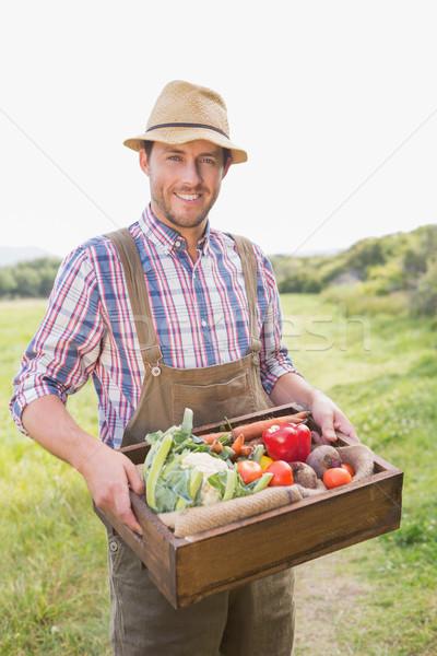 Happy farmer carrying box of veg Stock photo © wavebreak_media
