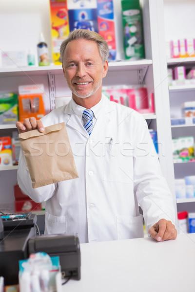 Senior pharmacist showing a envelope Stock photo © wavebreak_media