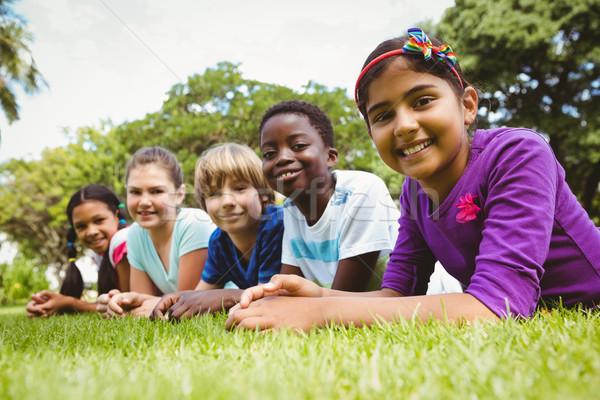 Portré boldog gyerekek fű park lány Stock fotó © wavebreak_media