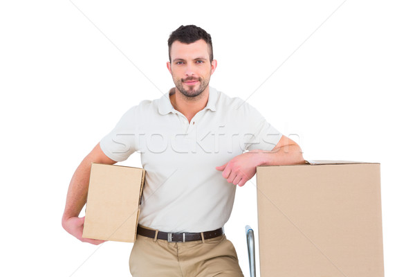 Delivery man with trolley of boxes  Stock photo © wavebreak_media