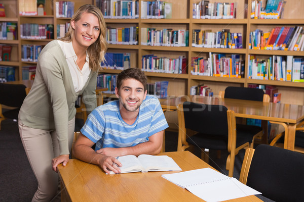 Student getting help from tutor in library Stock photo © wavebreak_media