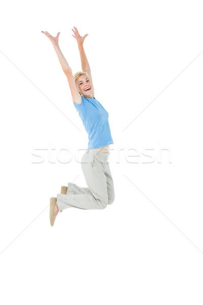 Sarışın kadın atlama beyaz mutlu kadın Stok fotoğraf © wavebreak_media