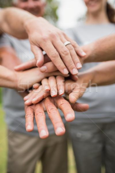 Heureux volontaire famille mains ensemble Photo stock © wavebreak_media