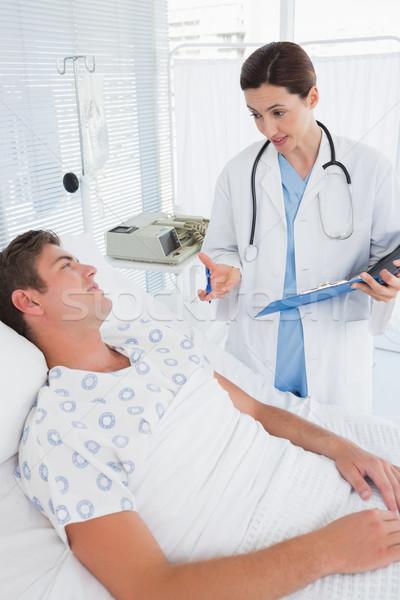 Doctor taking care of patient Stock photo © wavebreak_media