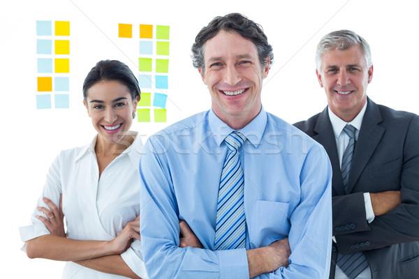 Sonriendo gente de negocios lluvia de ideas junto oficina mujer Foto stock © wavebreak_media