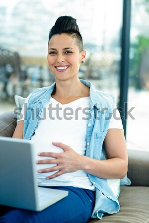 Smiling businesswoman with arms crossed Stock photo © wavebreak_media