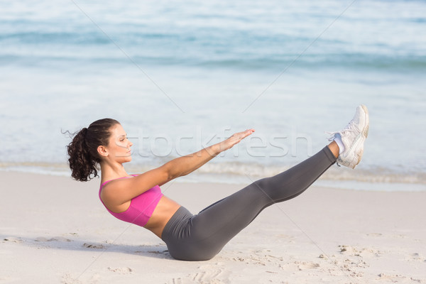 Dopasować kobieta fitness obok morza plaży Zdjęcia stock © wavebreak_media