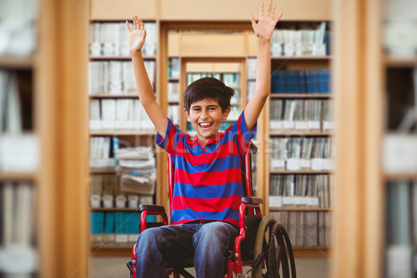 Composite image of boy in wheelchair in school corridor Stock photo © wavebreak_media