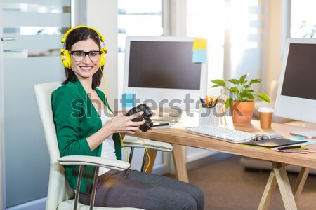 Casual designer using a graphics tablet  Stock photo © wavebreak_media