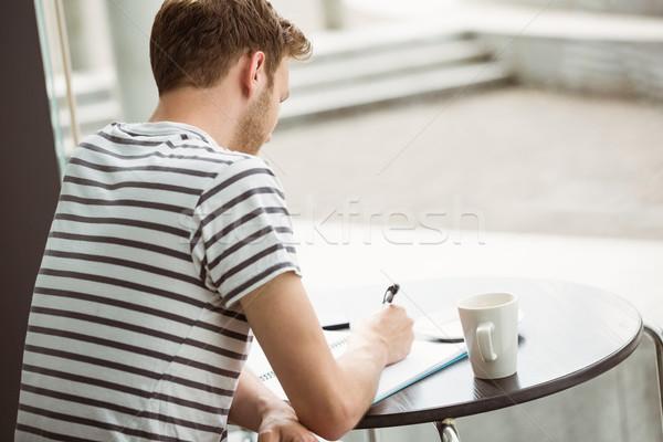 Diák ül forró ital ír jegyzettömb kávézó Stock fotó © wavebreak_media