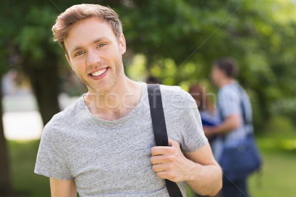 Przystojny student uśmiechnięty kamery na zewnątrz kampus Zdjęcia stock © wavebreak_media
