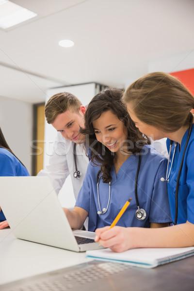 Tıbbi Öğrenciler oturma konuşma üniversite bilgisayar Stok fotoğraf © wavebreak_media