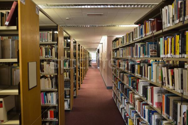 Livros prateleira de livros biblioteca universidade escolas educação Foto stock © wavebreak_media