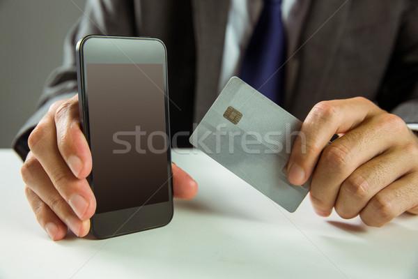 Empresário compras on-line negócio mão Foto stock © wavebreak_media