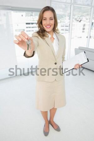 Businesswoman using her mobile phone Stock photo © wavebreak_media