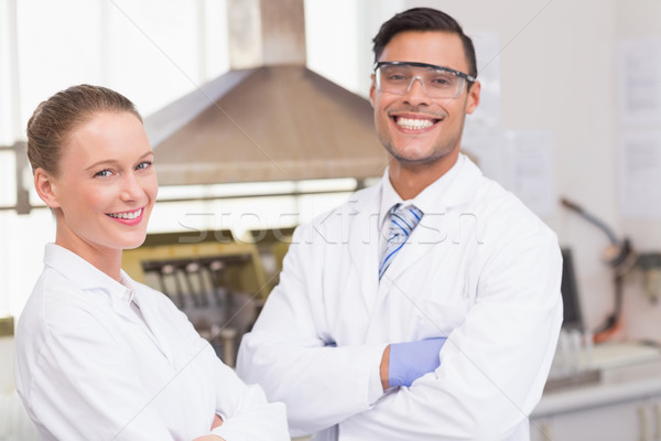 Happy scientists smiling at camera with arms crossed   Stock photo © wavebreak_media