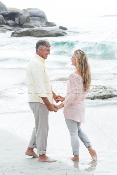 Boldog pár kéz a kézben mosolyog egyéb tengerpart Stock fotó © wavebreak_media