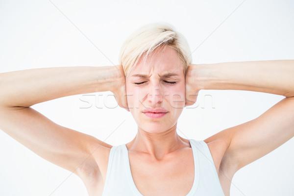 Upset woman covering her ears  Stock photo © wavebreak_media