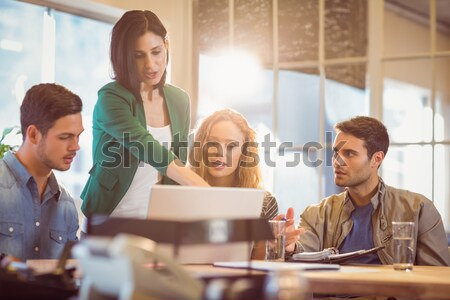 Group of young colleagues using laptop Stock photo © wavebreak_media