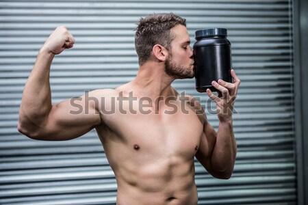 Portrait of muscular man leaning against gym equipment Stock photo © wavebreak_media